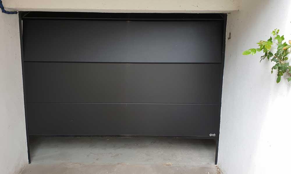 Porte garage sectionnelle noir sable bois colombes